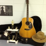 Hat, guitar, possum, trophy. In the green room at the Ozark Folk Center.